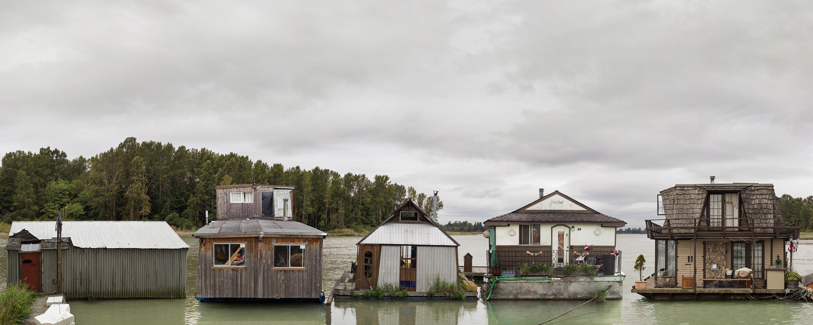 <p align=center><em>Floating Homes</em> <br />30″ x 75″, archival pigment print backmounted to aluminum, edition of 5<br /> 18″ x 45″, archival pigment print backmounted to aluminum, edition of 7</p>